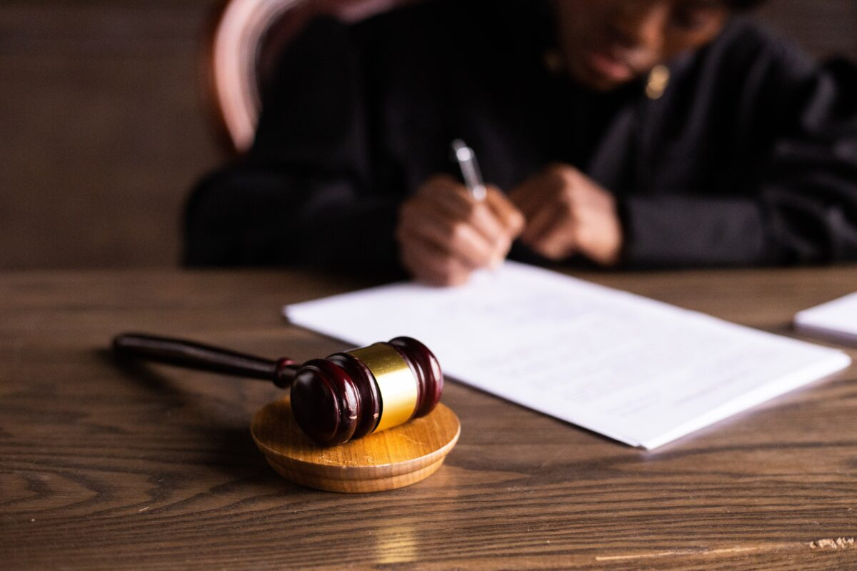 judge in robe writing on paper