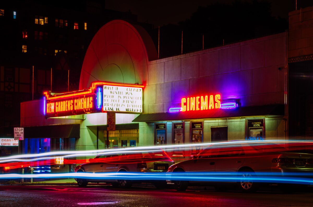 movie-theater-at-night-with-neon-signs