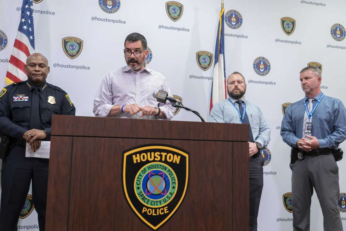Father speaks during a press conference announcing the arrest of son's shooter